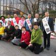 市役所前で新年のあいさつをした日本共産党の国会議員、市議・市議予定候補、県議=4日、北九州市